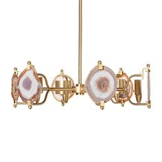 Finish: Satin Brass/Natural Agate  A paired down version of our bestseller, this chandelier is stunning combination of natural agate and simple accessories.  Emporium Home products are made with natural stones. Variations in the stone colors should be expected and are not considered defects. Stones can be hand selected. Additional fees will apply. Please call for details.