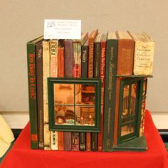 Exhibits at the Spring 2008 Seattle Dollhouse Show: A 1:12 scale cooking scene built inside a stack of cookbooks.