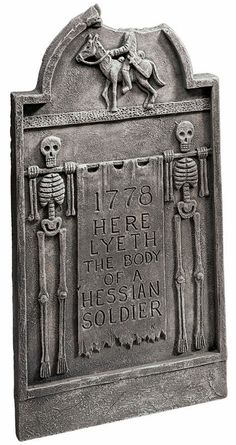 """Based on The Legend of Sleepy Hollow, this cleverly depicted tombstone marks the grave of the Hessian soldier who would become the Headless Horseman. Notice the perfectly placed """"missing"""" piece."""