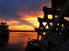 Sunset behind the Belle of Louisville on the Ohio River.