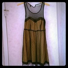 Urban Outfitters Gold and Black Lace Overlay Dress Adorable baby doll dress. Gold underneath with black lace overlay. Urban outfitters. No rips, stains or tears. Urban Outfitters Dresses