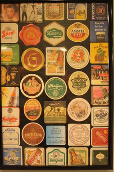 collage of beer coasters collected all over the world for decor in the bar