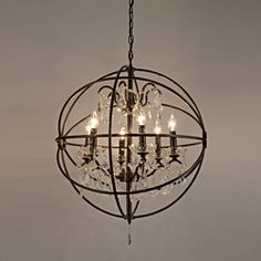 This wrought iron and crystal 6 light orb light fixture looks spectacular in any room. This beautifully unique version from the Versailles collection is made from 100 percent crystal that captures and reflects the light of the candle. Orb Chandelier, Iron Chandeliers, Modern Chandelier, Country Chandelier, Vintage Chandelier, Outlet Store, Online Outlet, Orb Light Fixture, Traditional Dining Rooms