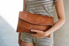 leather clutch and stripes