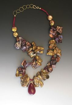 Yasek Design Jewlery: Florencia,  A 26-carat Ruby drop is the centerpiece of this golden Keshi pearl and small faceted Ruby necklace, with adjustable 14k hook/chain clasp.