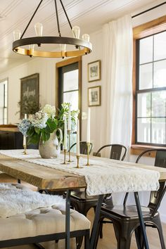 rustic table & edison bulb chandelier with bench & industrial style seating.