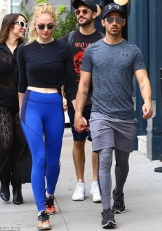 Lovers stroll: On Saturday, Sophie Turner, 21, was spotted wearing a J initial necklace in Los Angeles as she walked hand-in-hand with boyfriend Joe Jonas, 27