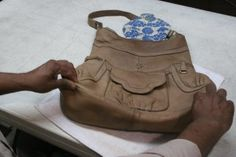 How to clean a leather purse.  I wish I had read this before I ruined one of mine :(