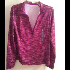 New long sleeve workout top Bright beautiful colors, light weight has a shirt zipper at the top. 93% polyester 7% spandex Tops