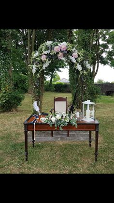 Outdoor Wedding Ceremony Floral Archway and Unity Candle Arrangement