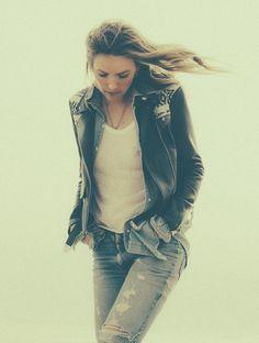 White top, jeans, denim jacket under black leather jacket, silver necklace