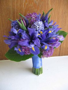 all purple bouquet with iris (would have deep purple iris instead of blue though)--this bouquet is lighter shades of purple but it has a nice mix of textures