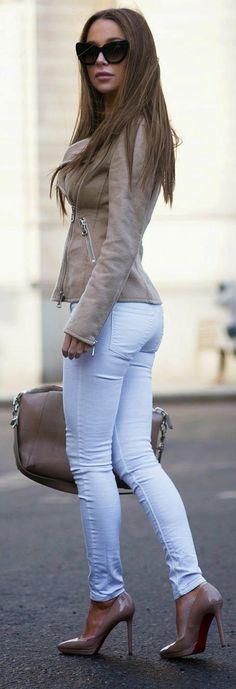 Shop this look on Lookastic:  https://lookastic.com/women/looks/biker-jacket-skinny-jeans-pumps-tote-bag-sunglasses/12376  — Black Sunglasses  — Tan Leather Biker Jacket  — Brown Leather Tote Bag  — Tan Leather Pumps  — White Skinny Jeans