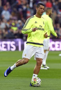 """Real Madrid's Portuguese forward Cristiano Ronaldo warms up before the Spanish league """"Clasico"""" football match FC Barcelona vs Real Madrid CF at the Camp Nou stadium in Barcelona on April 2, 2016."""