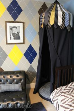 Menswear Inspired Vintage Preppy Boy's Bedroom: This little boys room is a true little gentleman's lounge, complete an argyle wall, kid-sized button tufted chairs, and a hanging play tent with men's neckties on top. {blue i style}