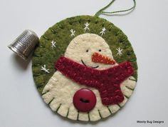 Ivory Wool Felt Snowman with Button and Handstitched Snowflakes on Green Wool Felt Ornament