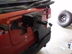 h2 tire carrier on a JK