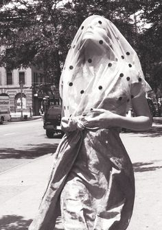 Eniko Mihalik/Another Magazine Fall Winter 2009 | spotted veil | veiled | street scene | fashion editorial | dots | scarf | walking | beautiful | simplicity | spots