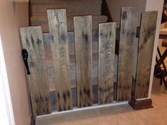 Baby gate made from a pallet. Total cost $15-$20 depending on the hinges and handle that you pick. I did put a clear coat on it after I was done sanding it. I chose a handle that is for screen doors and so it can lock from the inside. The best part is that my 5 year old can work it, I don't have to get up to open it each time for him.  Here is the link to my step by step tutorial.  http://davidandallisonhardy.blogspot.com/2015/01/diy-baby-gate-from-pallet-materials.html