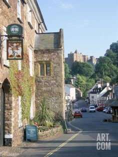 Luttrell Arms Hotel and Dunster Castle Beyond, Dunster, Somerset, England, United Kingdom Photographic Print by David Hunter at Art.com