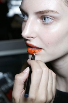 Orange Lipstick for Any Skin Tone: How to Wear the Summer's Hottest Trend  Read more: http://beautyhigh.com/orange-lipstick-any-skin-tone/#ixzz34la62d1W