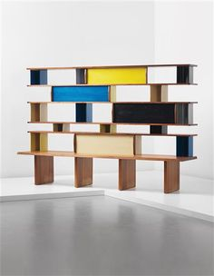 CHARLOTTE PERRIAND  Bibliothèque, circa 1954    Ash-veneered wood, painted bent steel, mahogany, oak.    80 1/8 x 120 1/8 x 26 1/2 in. (203.5 x 305 x 67.3 cm)    Manufactured by Les Ateliers Jean Prouvé, France.