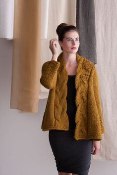"""Go There Now Mirrored-Cable Swing CoatAMY GUNDERSON A super bulky yarn makes a cabled sideways jacket easy to knit up. Fronts are curved with short rows and accented with a large cable for a swingy silhouette. FINISHED SIZE 151⁄4 (163⁄4, 18, 203⁄4, 22)"""" back width, from center of underarm to center of underarm. Jacket shown…"""