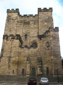 Newcastle Upon Tyne Castle, The monument includes the known extent of the buried remains of part of a Roman fort, an Anglo-Saxon cemetery, a motte and bailey castle, the upstanding and buried remains of a stone building associated with the graveyard, and a tower keep castle of medieval and post-medieval date, including a 17th century bastion.