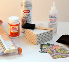 Make coasters from tiles and scrapbooking paper!  Mod Podge, felt, and sealer.