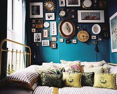 love this room color and the wall o' stuff. -especially the pocket watches!