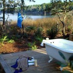 outdoor bathtub at the lake house