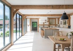 23 Rustic Country Kitchen Design Ideas to Jump Start Your Next Remodel - The Trending House Border Oak, Oak Frame House, Kitchen Corner, Kitchen Island, Wooden Cabinets, Wood Beams, Cuisines Design, Living Room Lighting, Kitchen Lighting