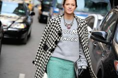 Shop this look for $129:  http://lookastic.com/women/looks/white-and-black-overcoat-and-grey-crew-neck-sweater-and-pink-statement-necklace-and-mint-pencil-skirt/1189  — White and Black Houndstooth Overcoat  — Grey Print Crew-neck Sweater  — Pink Statement Necklace  — Mint Boucle Pencil Skirt
