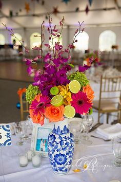 Vibrant decor- like the flowers and LOVe the limes in the bouquet, don't like the vase
