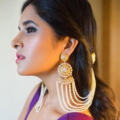 Add a little glam to your Indian wedding outfit by wearing these chic earrings. You can pair these trendy and classy earrings with any ethnic attire. OTT earrings will surely take your reception/haldi/mehndi/wedding outfit a notch higher. Indian Jewelry Earrings, Indian Jewelry Sets, Jewelry Design Earrings, Indian Wedding Jewelry, Ear Jewelry, Bridal Earrings, Bridal Jewelry, Ruby Jewelry, Indian Bridal