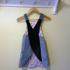 Upcycled denim girls Japanese cross back aprons. Handmade and unique. Perfect as a protective aprons, over tee shirt and jeans or as a dress. Versatile girls clothing