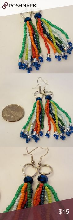 Multicolored bead dangle earrings Handmade multiple strands of different colored beads dangle earrings. Never been worn. See photo above for sizing reference. E24 none Jewelry Earrings