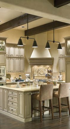 Beige linen colored kitchen cabinets with slightly darker for Houseplans bhg com