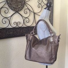 Pewter handbag with gold chain accent Pewter handbag comes with additional long strap. 3 compartment with middle zipper compartment inside for great organization. Bags