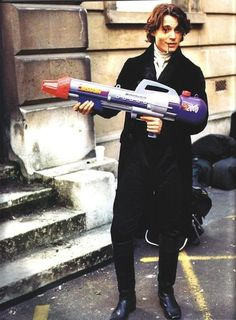 "Johnny Depp smoking a blunt and holding a super-soaker on the set of ""Sleepy Hollow"""