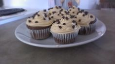 chocolate peanut butter cupcakes with peanut butter cream cheese frosting and a peanut butter surprise inside