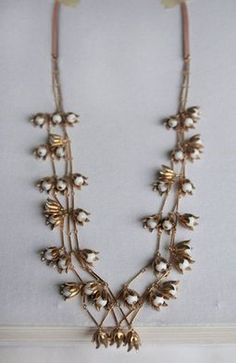 Gold vintage style Lily of the Valley floral necklace - Boho statement necklace - Gold flower necklace - Bridal wedding jewelry. $125.00, via Etsy.