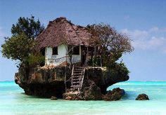 """rock restaurant..... built on a tiny rock in the ocean in Zanzibar, Tanzania. This lovely place is situated near the shore of the Michanwi Pingwe beach with a spectacular view at the Indian Ocean."""