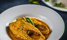 Ilish cooked in milk. Just a throw of kalonji some wicked green chillies and a luxuriant drizzle of mustard oil. Simple yet eclectic. Bangla Recipe, Nigella Seeds, Chilli Paste, Mustard Oil, Red Chili Powder, Red Chilli, Seafood Recipes, Thai Red Curry, Wicked