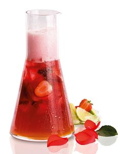 Fresh summer drink:  1 part Strawberry sparkling wine Fresita  1 part Fanta  Lots of strawberries and ice  Twist of lime  Decorate with rose leaf