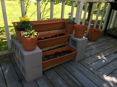 Plant stand made with cinder blocks and 2x4s... Can be any length