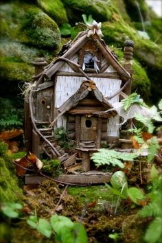 fairie house - i especially like the way the vine follows and forms the curve of the stairs, the wispy curtains - the owl on the chimney stack (?) is cute too, and I like the flower adornments at the peaks.   at the bottom - cute inspiration ***********************************************   Tatiana Katara for faeriefactory.com - #fairy #garden #house - t√