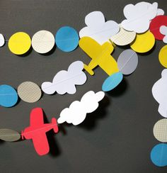 prop planes and clouds  paper garland by thekindpilot on Etsy, $20.00