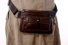 This brown leather hip bag was handmade by me using the finest Italian leather. Beautifully soft to touch, this black leather hip bag/travel pouch is comfortable and stylish. Handmade by me using the finest Italian leather which is super soft yet tough. It features two sections: A zipped pocket,in front of the pouch and a front pocket closed by magnetic clasps. It is large enough to hold a regular sized wallet, keys, phone, sunglasses and a few other small items. Fanny packs/b...