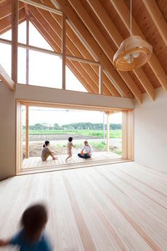 Large windows were added to this family house in rural Japan to offer panoramic views of the landscape from every room.